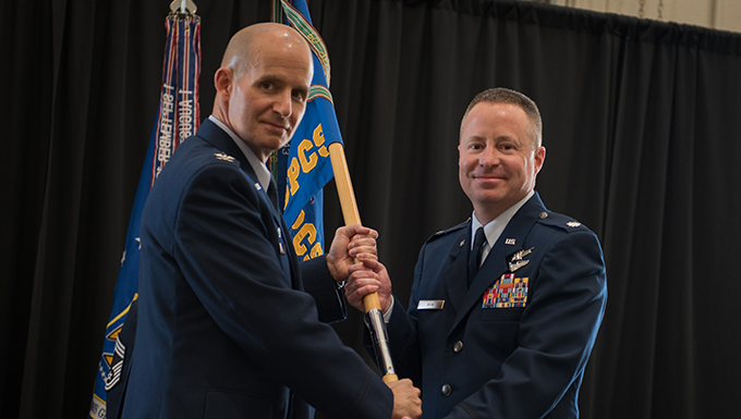 During the 380th Space Control Squadron change of command ceremony June 5, 2016 at Peterson Air Force Base, Colorado, Lt. Col. Jeffrey Akin accepts command from Col. Michael Assid.